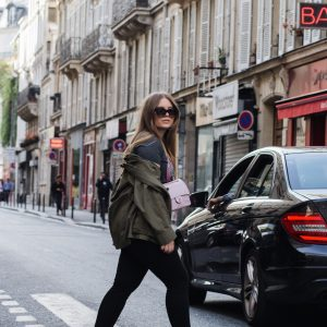 Blogger Dominique Candido wearing balenciaga speed runners, chanel bag, celine sunglasses and a alexander wang jacket
