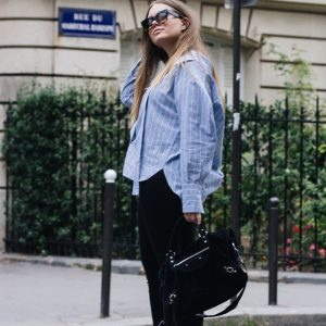 Blogger dominique candido wearin a rejina pyo shirt, ag jeans, celine sneakers, balenciaga bag and celine sunglasses