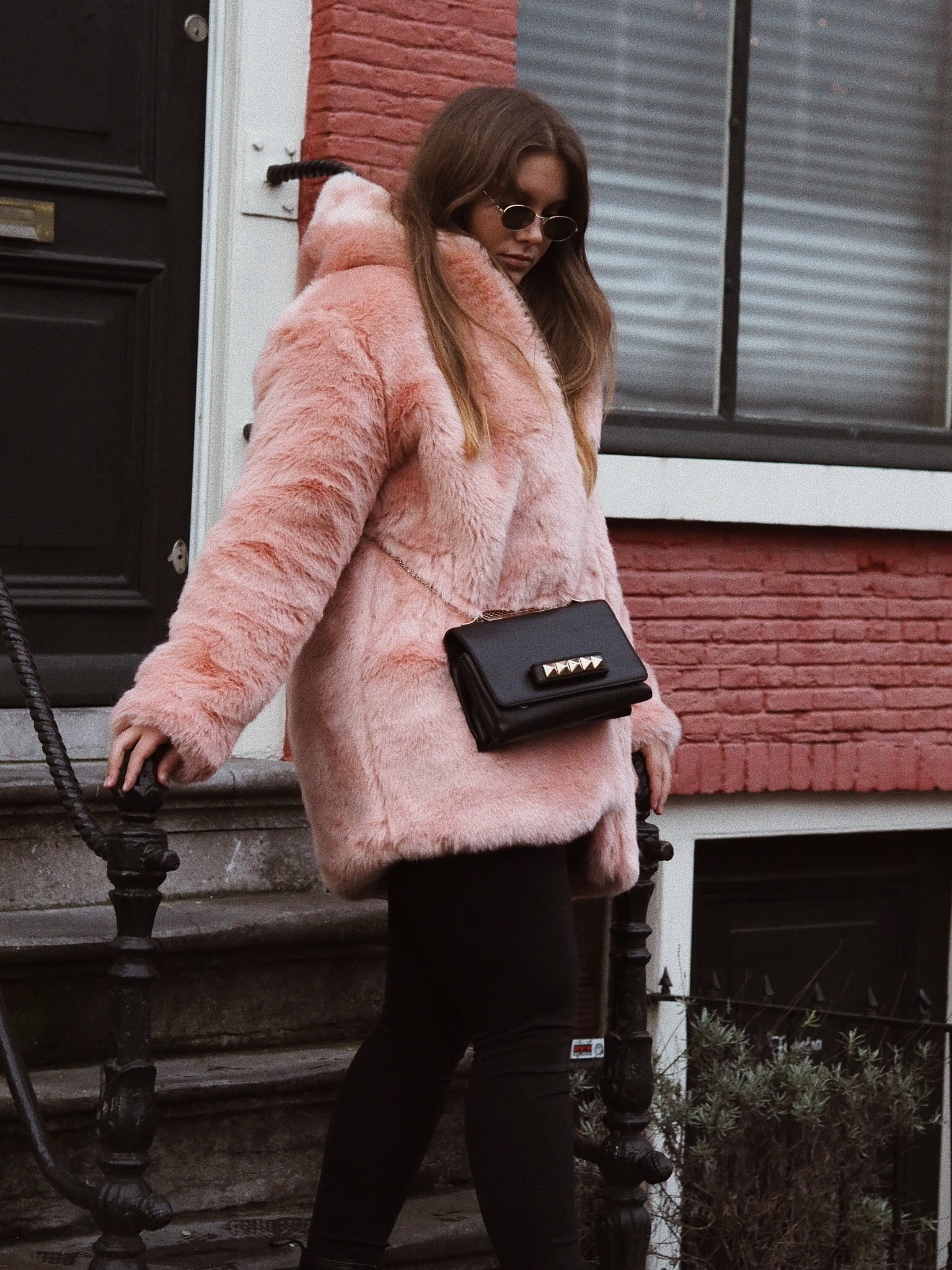 Blogger Dominique candido wearing lpa and lovers + friends sweater and Valentino va va room bag