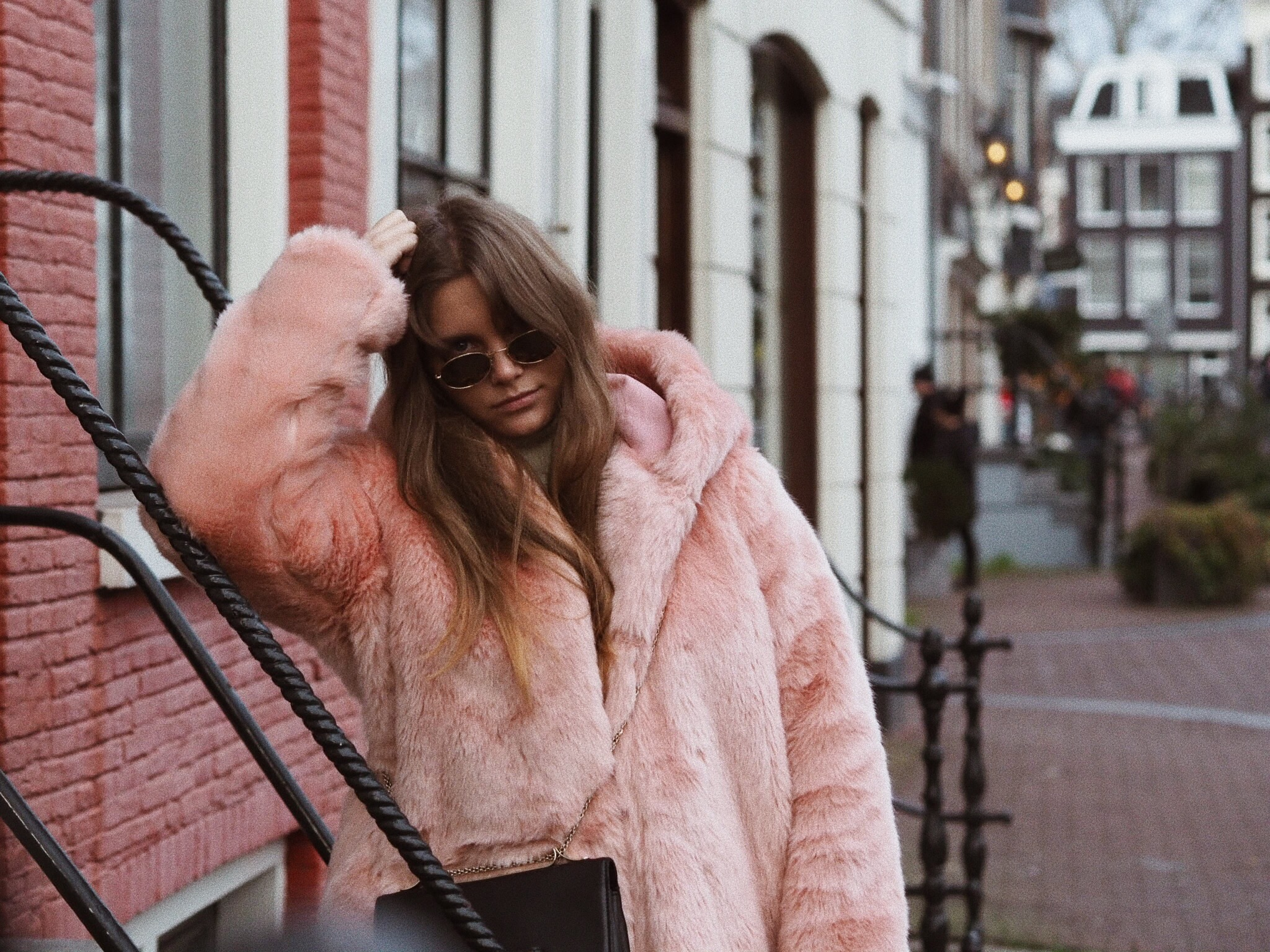 Blogger Dominique candido wearing lpa and lovers + friends sweater and a Valentino va va voom bag