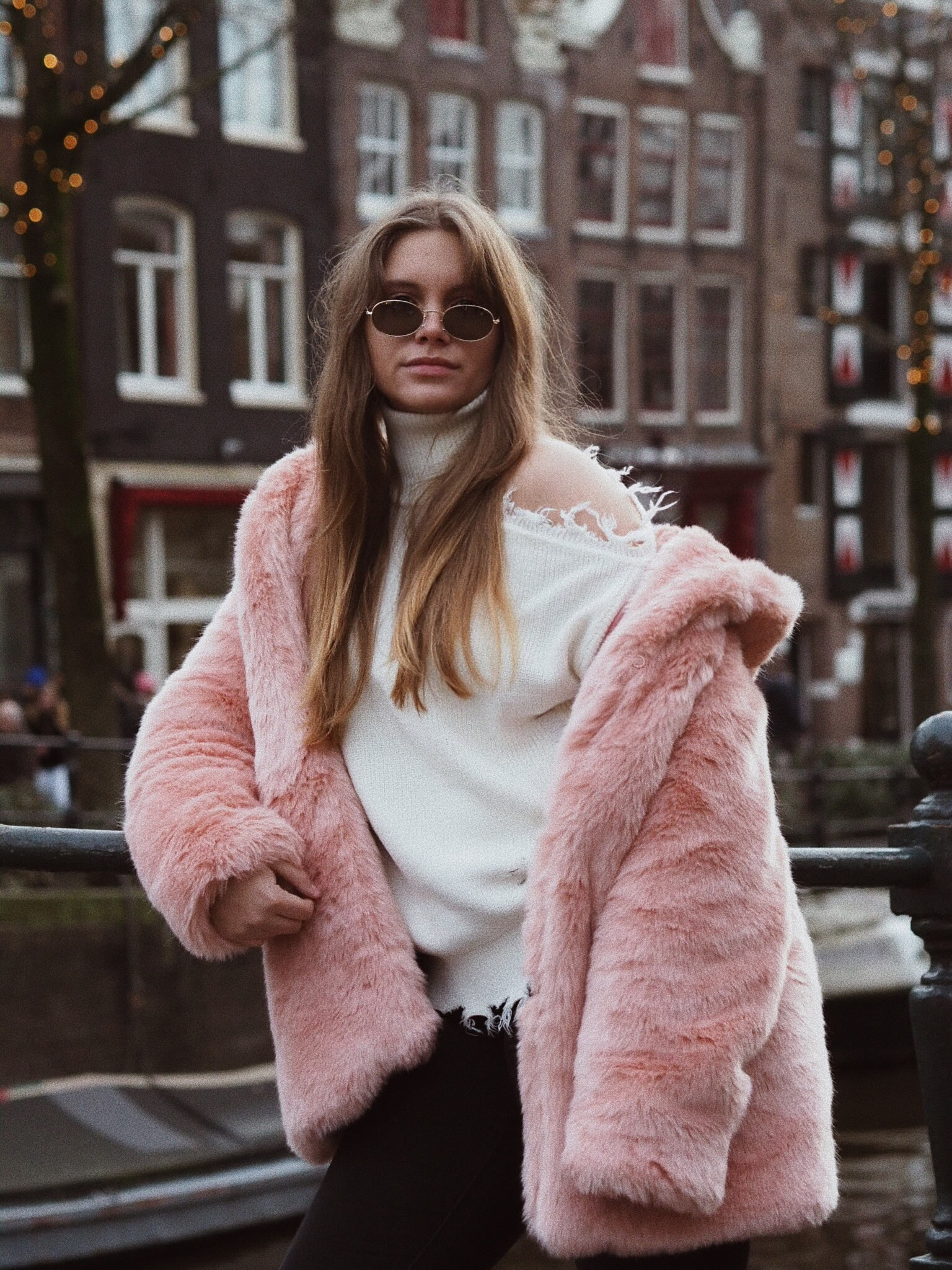 Blogger Dominique candido wearing lpa and lovers + friends sweater