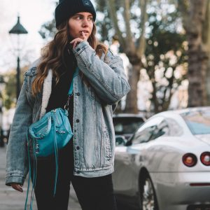 Blogger Dominique Candido wearing Acne Studios beanie and a levis jacket with balenciaga bag