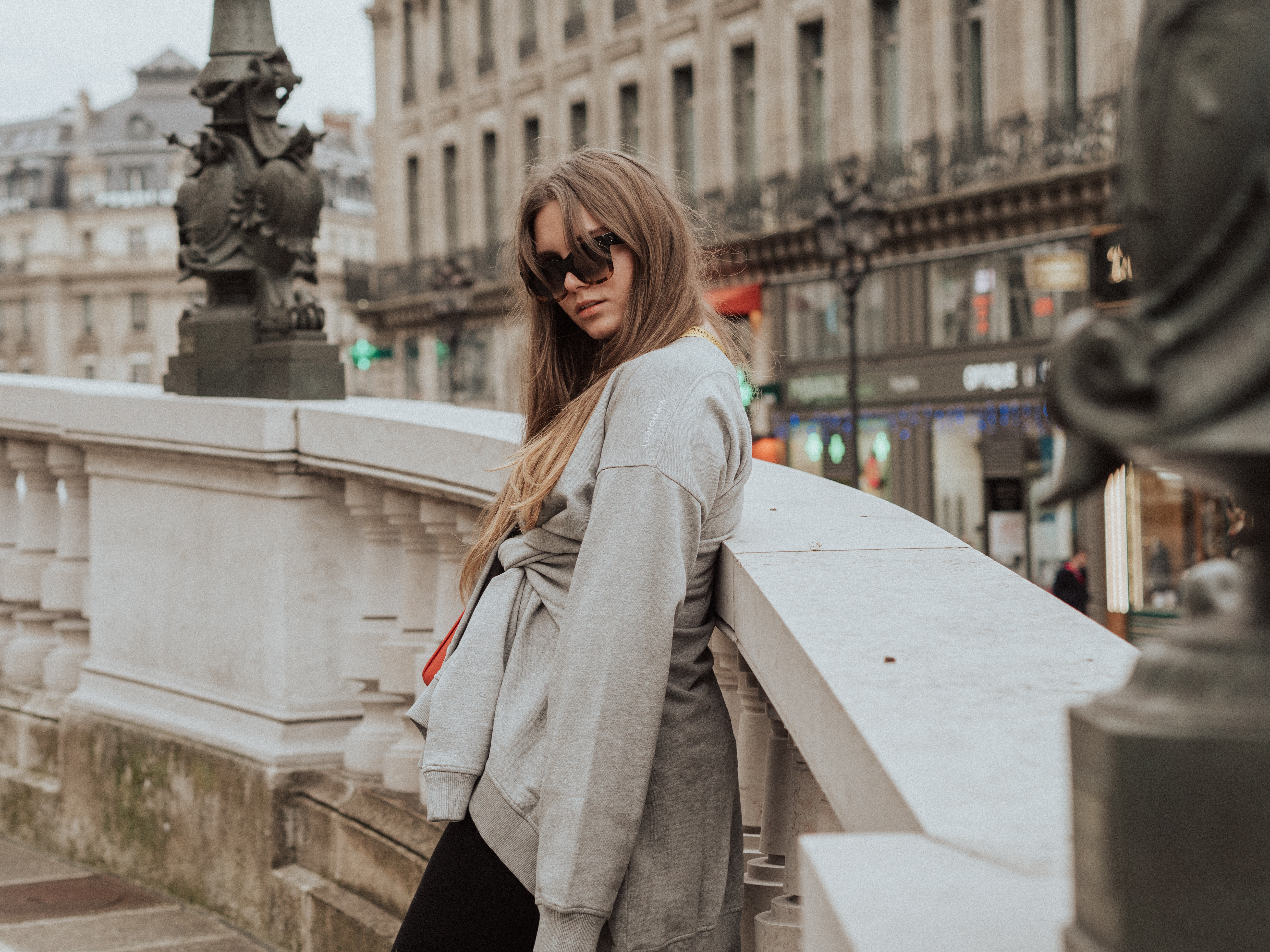 Fashion blogger Dominique Candido at PFW wearing Y Project, off white and Celine sunglasses, Balenciaga speed trainers
